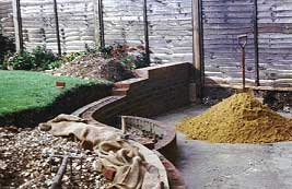 brick/block double skin retaining wall finished with a stock brick soldier course.